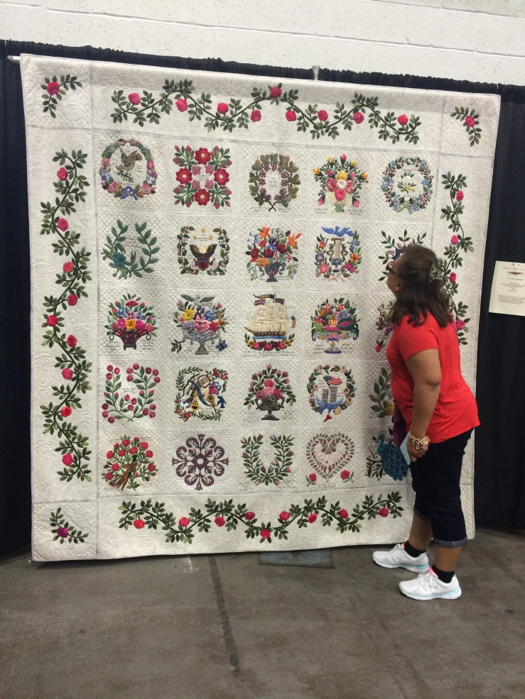 My mom taking a closer look at this quilt's details.
