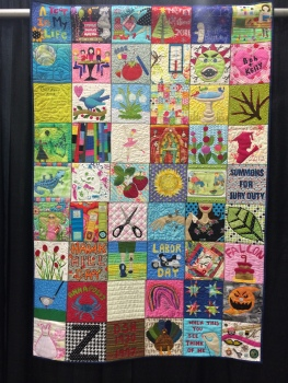 """Dear Diary"" by Kelly Meanix from Downingtown, PA. Hand and machine appliqued, machine pieced, machine quilted, original design. Kelly writes: Every week for one year I made a block of things that were going on in my life. I used different techniques and quilted them as I went. All blocks are also documented with more information on the back on the quilt."