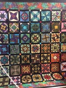 A quilt made to look like stained glass.