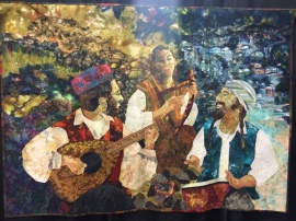 "World Quilt Competition XVIII: Best of Country, Israel - ""My Brothers I Seek"" by Shani Leser. Machine appliqued, machine quilted, original design. Shani writes: Watching these three brothers, listening to their music and their laughter, I was captivated by the energy that flowed between them, uniting them in an invisible bond of love despite their differences. It brought to mind the Biblical story of Joseph searching for his brothers and for brotherhood, ""...my brothers I seek."" The technique that I used is machine raw edge applique with zigzag stitch and machine quilting. I used pastel crayons to enhance the faces and the hands."