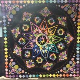 "Best Use of Color: ""Sedona Star"" by Ellen Conoscenti from Yardley, PA. This was from the Block of the Month program from The Quilt Show. It was designed by Sarah Vedler. Marchine appliqued, machine pieced, long arm quilted by Diana Leslie."